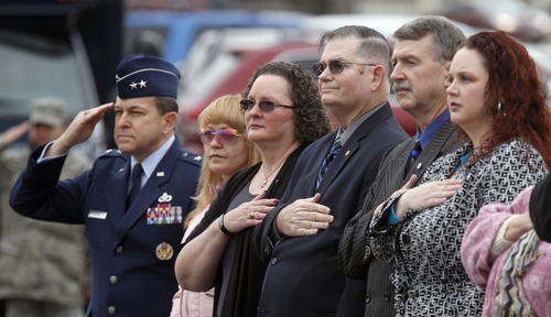 Al Hartmann  |  The Salt Lake Tribune Air Force Maj. Gen. Timothy Byers, left, joins family members Lilia Solesbee, wife; Sandy Parker, mother; Louis Parker, stepfather; Larry Solesbee, father and Trina Solesbee, sister of Tech Sgt. Kristoffer Solesbee, who died May 26, 2011, in Afghanistan. Hill Air Force Base renamed 12th Street to Solesbee Street on Tuesday  to honor him. He was a bomb dismantler assigned to Hill AFB's 775th Civil Engineer Squadron Explosive Ordnance Disposal.