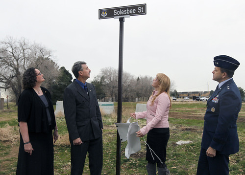 Al Hartmann  |  The Salt Lake Tribune  Sandy Parker, mother, left; Larry Solesbee, father; Lilia Solesbee, wife, and Maj. Gen. Timothy Byers uncover a street sign honoring Tech Sgt. Kristoffer Solesbee who died May 26, 2011, in Afghanistan. The Solesbee family joined Hill Air Force Base personnel Tuesday in a ceremony to rename 12th Street to Solesbee Street. He was a bomb dismantler assigned to Hill AFB's 775th Civil Engineer Squadron Explosive Ordnance Disposal.