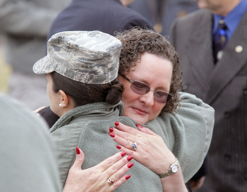 Al Hartmann  |  The Salt Lake Tribune  Sandy Parker, mother of Tech Sgt. Kristoffer Solesbee, gets a comforting hug from a Hill Air Force Base airman on Tuesday. The base held a ceremony to rename 12th Street to Solesbee Street to honor Solesbee, who was killed in Afghanistan in 2011.