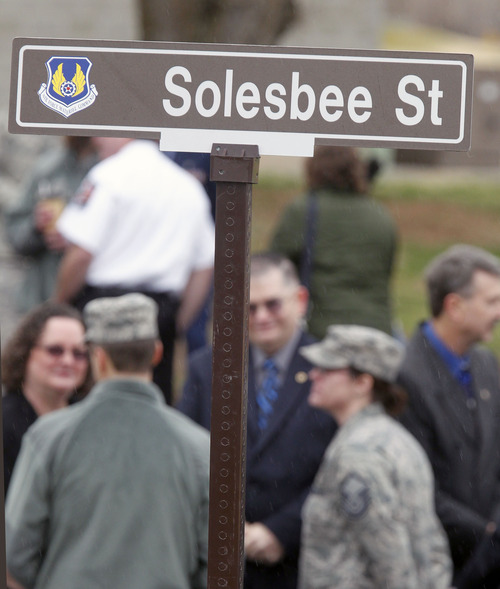 Al Hartmann  |  The Salt Lake Tribune  Family members of Tech Sgt. Kristoffer Solesbee -- who died in 2011 in Afghanistan from wounds from an improvised explosive device -- join Hill Air Force Base personnel on Tuesday in a ceremony to rename 12th Street to Solesbee Street. Solesbee was a bomb dismantler assigned to Hill AFB's 775th Civil Engineer Squadron Explosive Ordnance Disposal.