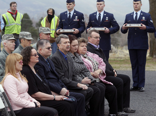 Al Hartmann  |  The Salt Lake Tribune  Family members of Tech Sgt. Kristoffer Solesbee sit somberly during a Tuesday ceremony at Hill Air Force Base.
