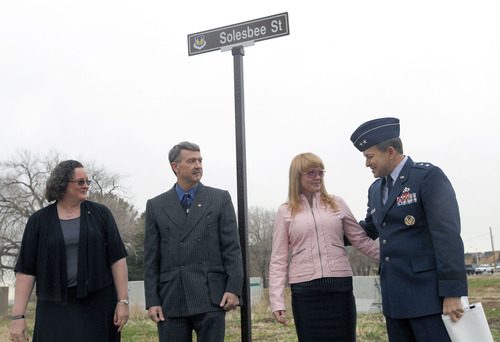 Al Hartmann  |  The Salt Lake Tribune  Sandy Parker, mother, left; Larry Solesbee, father; Lilia Solesbee, wife, and Maj. Gen. Timothy Byers uncover a street sign honoring Tech Sgt. Kristoffer Solesbee on Tuesday.