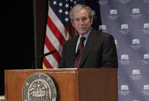 "Former President George W. Bush gives opening remarks at the Federal Reserve Bank of Dallas for a conference titled ""Immigration and 4% Growth: How Immigrants grow the U.S. Economy,"" Tuesday, Dec. 4, 2012, in Dallas.  The George W. Bush Institute is hosting panel discussions highlighting the positive impact of immigration on U.S. economic growth. (AP Photo/LM Otero)"