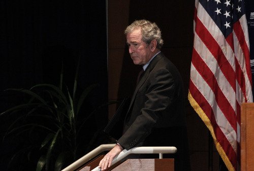 "Former President George W. Bush walks off the stage after giving opening remarks at the Federal Reserve Bank of Dallas for a conference titled ""Immigration and 4% Growth: How Immigrants grow the U.S. Economy,"" Tuesday, Dec. 4, 2012, in Dallas.  The George W. Bush Institute is hosting panel discussions highlighting the positive impact of immigration on U.S. economic growth. (AP Photo/LM Otero)"