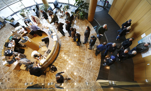 People line up to get registered before the auction of personal and corporate property belonging to Russ Wasendorf Sr. at Peregrine Financial Group inc. headquarters, Wednesday, Dec. 5, 2012, in Cedar Falls, Iowa. (AP Photo/The Waterloo Courier, Matthew Putney)
