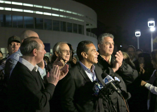 Mayor Antonio Villaraigosa announces the end of the week old Ports of Los Angeles and Port of Long Beach strikes during a news conference Tuesday night Dec 4, 2012 in Wilmington, Calif. Clerical workers and longshoremen at the nation's largest port complex will return to work Wednesday, eight days after they walked out in a crippling strike that prevented shippers from delivering billions of dollars in cargo across the country. (AP Photo/Chuck Bennett, Daily Breeze)
