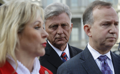 National Governors Association (NGA) Executive Committee member, Arkansas Gov. Mike Beebe, center, listens to NGA Vice Chair,  Oklahoma Gov. Mary Fallin, left, and NGA Chairman, Delaware Gov. Jack Markell, right, talks to reporters  outside the West Wing of the White House in Washington, Tuesday, Dec. 4, 2012, following their meeting with President Barack Obama regarding the fiscal cliff. (AP Photo/Pablo Martinez Monsivais)
