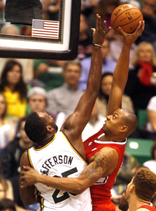 Rick Egan    The Salt Lake Tribune   Utah Jazz center Al Jefferson (25) defends as Los Angeles Clippers small forward Caron Butler (5) goes up for a shot, in NBA action. The Los Angeles Clippers beat the Jazz 105-104, in Salt Lake City, Monday, December 3, 2012.