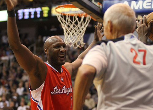 Rick Egan    The Salt Lake Tribune   Los Angeles Clippers power forward Lamar Odom (7) complains to referee Dick Bavetta (27) in NBA action. The Los Angeles Clippers beat the Jazz 105-104, in Salt Lake City, Monday, December 3, 2012.