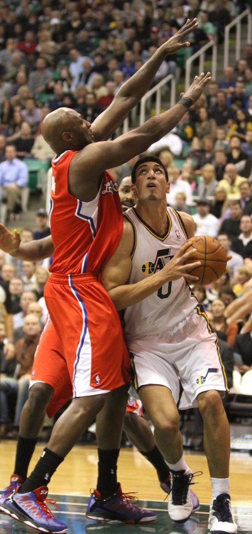Rick Egan    The Salt Lake Tribune   Los Angeles Clippers power forward Lamar Odom (7) defends as Utah Jazz center Enes Kanter (0) looks for a shot, in NBA action. The Los Angeles Clippers beat the Jazz 105-104, in Salt Lake City, Monday, December 3, 2012.