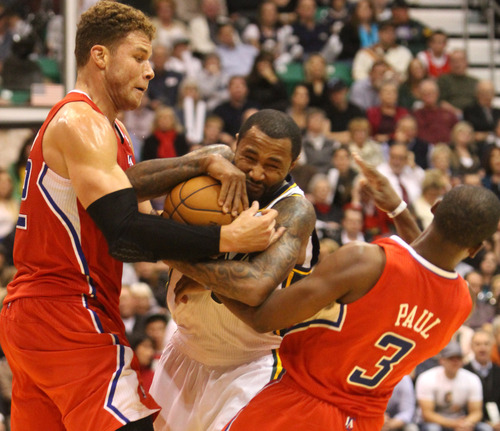 Rick Egan    The Salt Lake Tribune   Utah Jazz point guard Mo Williams (5) is called for a foul as he is double teamed by Los Angeles Clippers power forward Blake Griffin (32) (left) and Los Angeles Clippers point guard Chris Paul (3) (right) in NBA action. The Los Angeles Clippers beat the Jazz 105-104, in Salt Lake City, Monday, December 3, 2012.