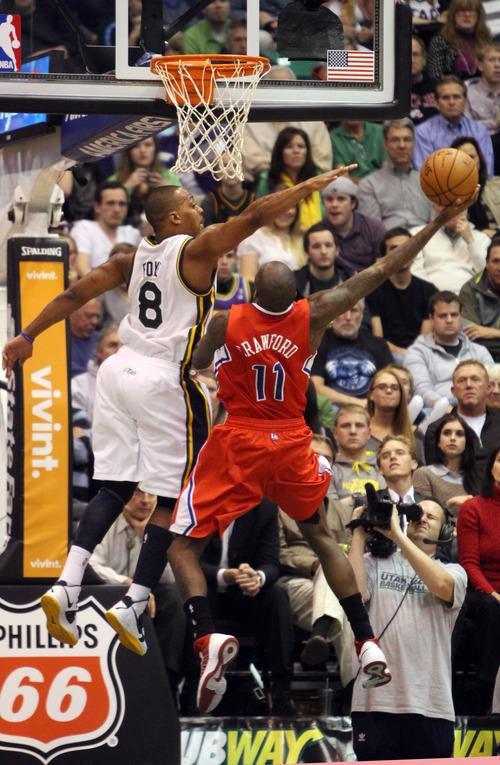 Rick Egan    The Salt Lake Tribune   Utah Jazz point guard Randy Foye (8) defends as Los Angeles Clippers shooting guard Jamal Crawford (11) shoots, in NBA action. The Los Angeles Clippers beat the Jazz 105-104, in Salt Lake City, Monday, December 3, 2012.