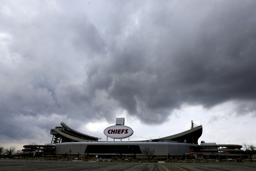 Clouds pass above Arrowhead Stadium, home to the Kansas City Chiefs NFL football team, Monday, Dec. 3, 2012, in Kansas City, Mo. The team is still recovering from a murder-suicide committed by linebacker Jovan Belcher Saturday morning. Belcher shot and killed his 22-year-old girlfriend, Kasandra Perkins, at their Kansas City home before driving to the stadium, where Belcher committed suicide in the practice facility's parking lot after meeting with head coach Romeo Crennel and general manager Scott Pioli, police said. (AP Photo/Charlie Riedel)