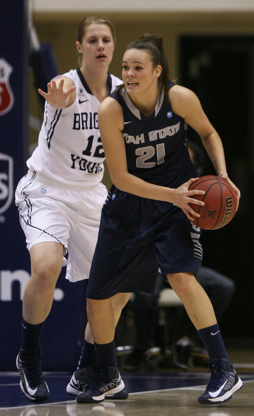 Steve Griffin   The Salt Lake Tribune   USU's Makenlee WIlliams looks for help during game against BYU at the Marriott Center in Provo, Utah Tuesday December 4, 2012.