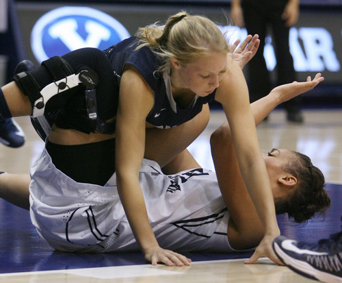 Steve Griffin   The Salt Lake Tribune   USU's Elise Nelson crashes to the floor on top of BYU's Morgan Bailey during game at the Marriott Center in Provo, Utah Tuesday December 4, 2012.