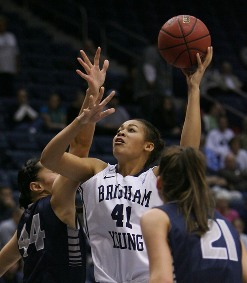 Steve Griffin   The Salt Lake Tribune   BYU's Morgan Bailey shoots from the lane during game against Utah State University at the Marriott Center in Provo, Utah Tuesday December 4, 2012.