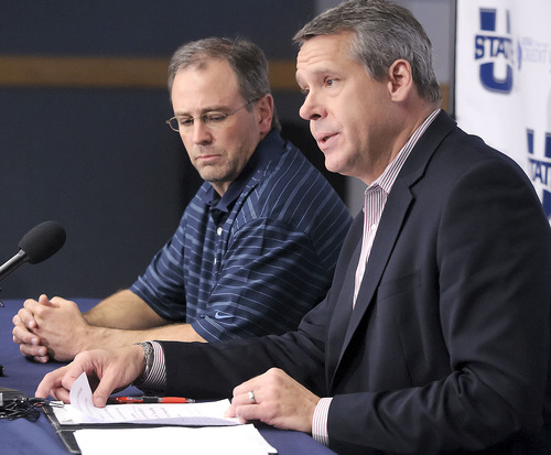 Athletics Director Scott Barnes, right, and Dr. Trek Lyons, who is the team physician for Utah State University, participate in a press conference to discuss the health of basketball player Danny Berger, Wednesday, Dec. 5, 2012 in Logan, Utah. Berger went into full cardiac arrest during practice on Tuesday and was revived by a trainer using CPR and a defibrillator. (AP Photo/The Herald Journal, Eli Lucero)