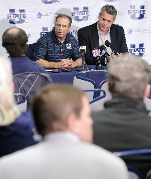 Dr. Trek Lyons, left, who is the team physician for Utah State University, and Athletics Director Scott Barnes participate in a press conference to discuss the health of basketball player Danny Berger, Wednesday, Dec. 5, 2012 in Logan, Utah. Berger went into full cardiac arrest during practice on Tuesday and was revived by a trainer using CPR and a defibrillator. (AP Photo/The Herald Journal, Eli Lucero)