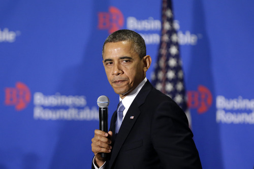 """President Barack Obama pauses as he speaks about the fiscal cliff at the Business Roundtable, an association of chief executive officers, in Washington, Wednesday, Dec. 5, 2012.  The president warned Republicans not to create another fight over the nation's debt ceiling, telling business leaders it's """"not a game that I will play.""""  (AP Photo/Charles Dharapak)"""