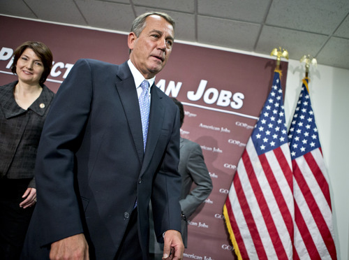 House Speaker John Boehner, of Ohio, and the House GOP leadership leave after a news conference on Capitol Hill in Washington, Wednesday, Dec. 5, 2012, following a closed-door GOP strategy session. At left is Rep. Cathy McMorris Rodgers, R-Wash. (AP Photo/J. Scott Applewhite)