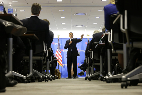 """President Barack Obama gestures as he speaks about the fiscal cliff at the Business Roundtable, an association of chief executive officers, in Washington, Wednesday, Dec. 5, 2012.  The president warned Republicans not to create another fight over the nation's debt ceiling, telling business leaders it's """"not a game that I will play."""" (AP Photo/Charles Dharapak)"""