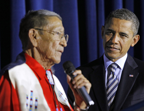 "FILE - In this Friday, Dec. 2, 2011 file photo, President Barack Obama listens as Hartford ""Sonny"" Black Eagle delivers remarks at the White House Tribal Nations Conference at the Interior Department in Washington. Native American tribal leaders are concerned that steady progress on their issues might be undermined if President Barack Obama and Congress make deep spending cuts in order to avoid the ""fiscal cliff."" More than 500 tribal leaders were taking those concerns to the fourth White House Tribal Nations summit, which convenes Wednesday, Dec. 5, 2012. Obama is scheduled to address the group in the afternoon. (AP Photo/Haraz N. Ghanbari, File)"