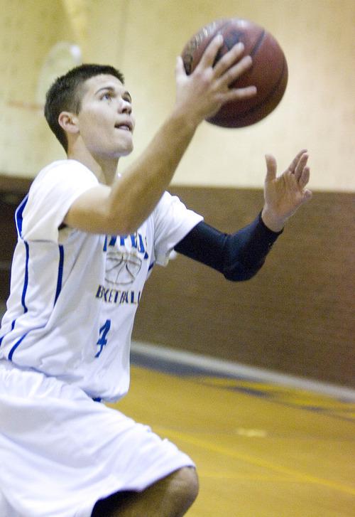 Paul Fraughton  |  Salt Lake Tribune Cyprus High School senior guard, Connor Squire at a recent team practice.
