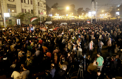 Egyptian protesters chant anti Muslim Brotherhood and Egyptian President Morsi slogans outside the presidential palace in Cairo, Egypt, Thursday, Dec. 6, 2012. The Egyptian army has deployed tanks outside the presidential palace in Cairo following clashes between supporters and opponents of Mohammed Morsi that left several people dead and hundreds wounded. (AP Photo/Hassan Ammar)