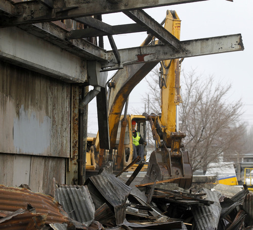 Al Hartmann     The Salt Lake Tribune Backhoe demolishes old blighted warehouse building at the corner of 200 South and 600 West in Salt Lake City Thursday, December 6. The property is north of the UTA Central Station and Intermodal Hub.