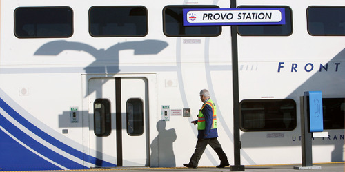 Steve Griffin    The Salt Lake Tribune People walk past a FrontRunner train at the Provo Station during UTA ceremony to open the commuter rail line between Salt Lake City and Provo.