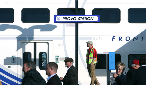 Steve Griffin |  The Salt Lake Tribune People walk past a FrontRunner train at the Provo Station during UTA ceremony to open the new commuter rail line between Salt Lake City and Provo Thursday December 6, 2012.