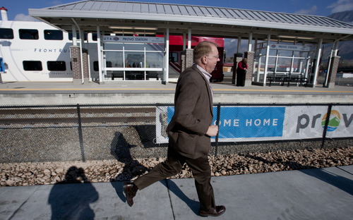 Steve Griffin |  The Salt Lake Tribune Passengers run to board a FrontRunner train as it prepares to leave the Provo Station following a UTA ceremony to open the new commuter rail line between Salt Lake City and Provo Thursday, December 6, 2012.
