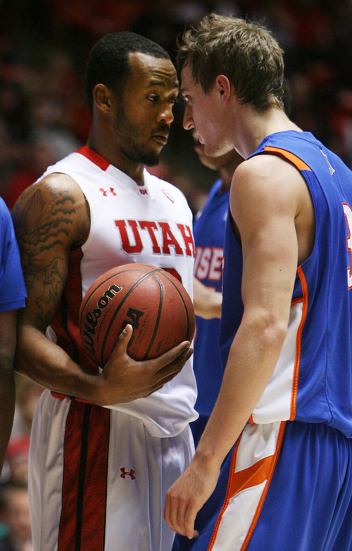 Steve Griffin | The Salt Lake Tribune   Utah's Aaron Dotson and Boise State's Anthony Drmic go nose to nose as tempers flair during second-half play at the Huntsman Center  in Salt Lake City on Wednesday, Dec. 5, 2012.