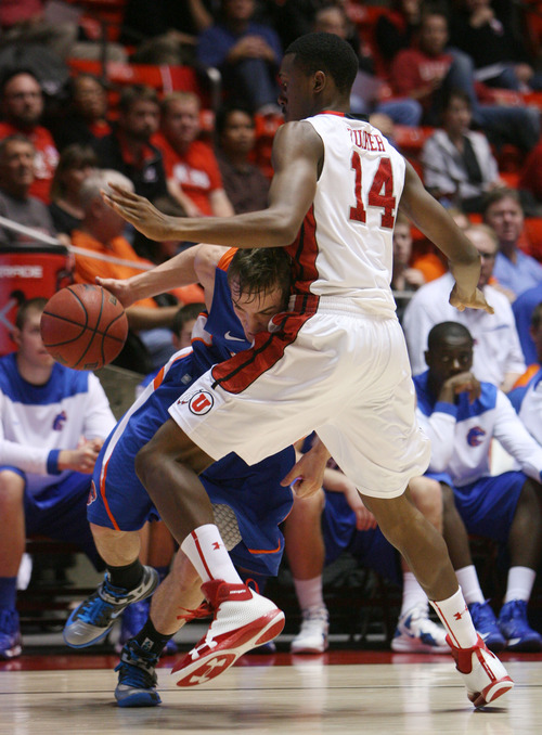 Steve Griffin | The Salt Lake Tribune   Boise State's Anthony Drmic tries to drive around Utah's Dakari Tucker during second-half action at the Huntsman Center  in Salt Lake City on Wednesday, Dec. 5, 2012.