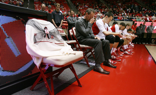 Steve Griffin | The Salt Lake Tribune An emotional Utah assistant coach, Tommy Connor, wipes his eyes during a moment of silence in honor of former head coach Rick Majerus, who passed away Dec. 1, 2012. A white University of Utah sweater, a  Majerus trademark, is draped over a chair with a black ribbon on the University of Utah's bench, in honor of the former head coach. He was remembered during a short ceremony before the start of the Utah game against Boise State at the Huntsman Center in Salt Lake City on Wednesday, Dec. 5, 2012.  Connor was an assistant coach under Majerus.