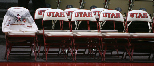 Steve Griffin | The Salt Lake Tribune A white University of Utah sweater, a Rick Majerus trademark, is draped over a chair with a black ribbon, on the University of Utah's bench in honor of the former head coach who passed away. He was remembered during a short ceremony before the start of the Utah game against Boise State  in Salt Lake City on Wednesday, Dec. 5, 2012.