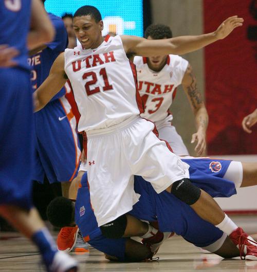 Steve Griffin | The Salt Lake Tribune   Utah's jordan Loveridge grimaces as his leg gets pinned under a Boise State player during first-half play at the Huntsman Center  in Salt Lake City on Wednesday, Dec. 5, 2012.