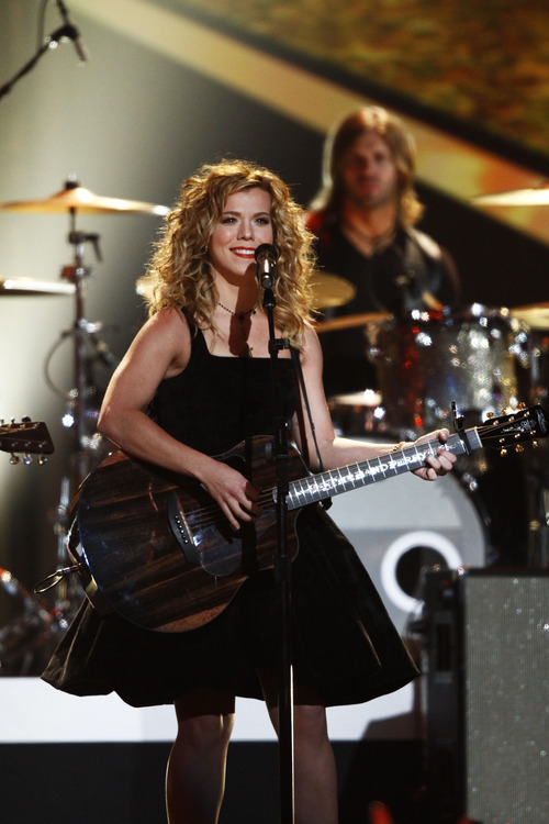 Kimberly Perry, of musical group The Band Perry, performs at the Grammy Nominations Concert Live! at Bridgestone Arena on Wednesday, Dec. 5, 2012, in Nashville, Tenn. (Photo by Wade Payne/Invision/AP)