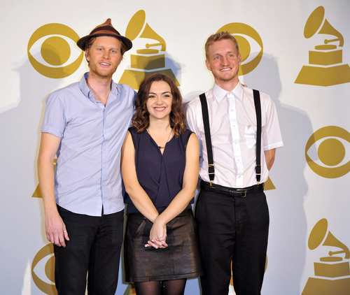 The Lumineers, from left, Wesley Schultz, Neyla Pekarek and Jeremiah Fraites, pose for a photo backstage at the Grammy Nominations Concert Live! at Bridgestone Arena on Wednesday, Dec. 5, 2012, in Nashville, Tenn. (Photo by Donn Jones/Invision/AP)