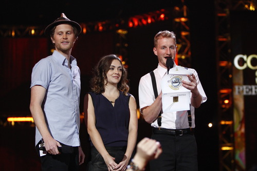 From left, Wesley Schultz, Neyla Pekarek and Jeremiah Fraites, of musical group The Lumineers, announce the nominees for best country solo perfomance at the Grammy Nominations Concert Live! at Bridgestone Arena on Wednesday, Dec. 5, 2012, in Nashville, Tenn. (Photo by Wade Payne/Invision/AP)
