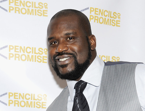 """FILE - This Nov. 17, 2011 file photo shows Shaquille O'Neal at the """"Pencils Of Promise"""" inaugural gala in New York. O'Neal is providing a forum for comics for his """"All Star Comedy Jam"""" tour.  The twenty-city tour includes urban comics Kevin Hart, Finesse Mitchell, and Gary Owen. The tour ends on New Year's Eve in Atlanta.  (AP Photo/Evan Agostini, file)"""