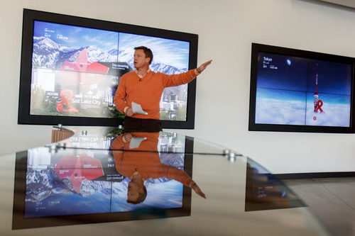 Trent Nelson  |  The Salt Lake Tribune Mike Herring, vice president of operations, stands in front of large touchscreen displays at the new Adobe building Thursday December 6, 2012 in Lehi.
