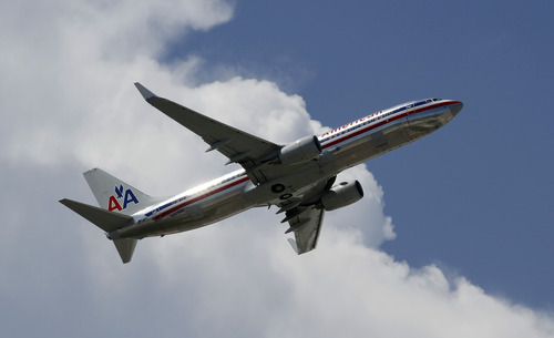 (AP Photo/Alan Diaz) American Airlines pilots will be flying under a new labor agreement approved Friday by union members.