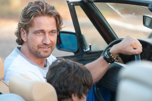 """This film image released by FilmDistrict shows Gerard Butler in a scene from """"Playing for Keeps."""" (AP Photo/FilmDistrict, Dale Robinette)"""