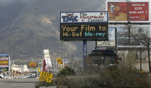 Rick Egan  | The Salt Lake Tribune Salt Lake County has passed an ordinance regulating electronic messaging signs, limiting how often they can change and how much animation is allowed. Several electronic messaging signs are seen on 3300 South at about 2900 East.