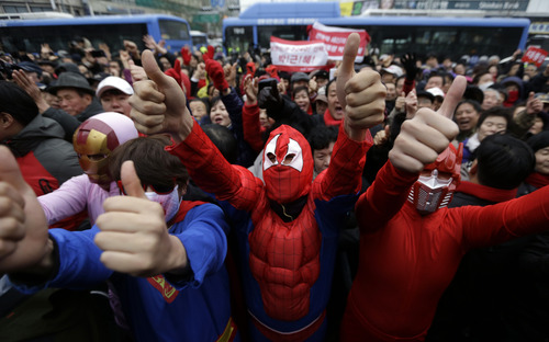 Supporters of South Korea's presidential candidate Park Geun-hye of ruling Saenuri Party in costumes give thumbs-up signs during her presidential election campaign in Seoul, South Korea, Friday, Dec. 7, 2012. South Korea's presidential election is scheduled for Dec. 19. (AP Photo/Lee Jin-man)