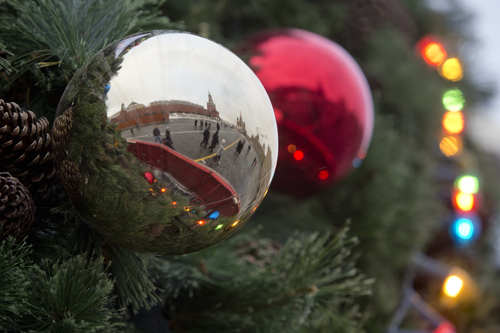 Moscow's Kremlin is reflected in Christmas-tree decoration balls hung on a Christmas tree in Red Square on Friday, Dec. 7, 2012.  New Year's is the biggest holiday of the year in Russia. (AP Photo/Misha Japaridze)