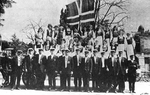 Costumed members of the Norwegian Glee Club, Det Norske Sangkor, displaying Norwegian flag. Photo Courtesy Utah State Historical Society