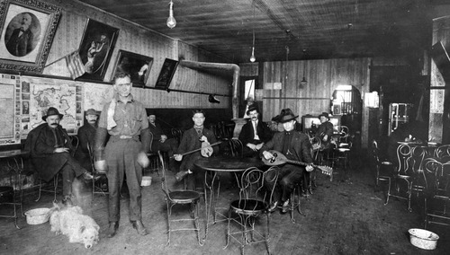 The Open Heart coffeehouse in Greek Town, Salt Lake City in the 1920's. Owner Emmanuel Katsanevas is standing. Photo Courtesy Utah State Historical Society
