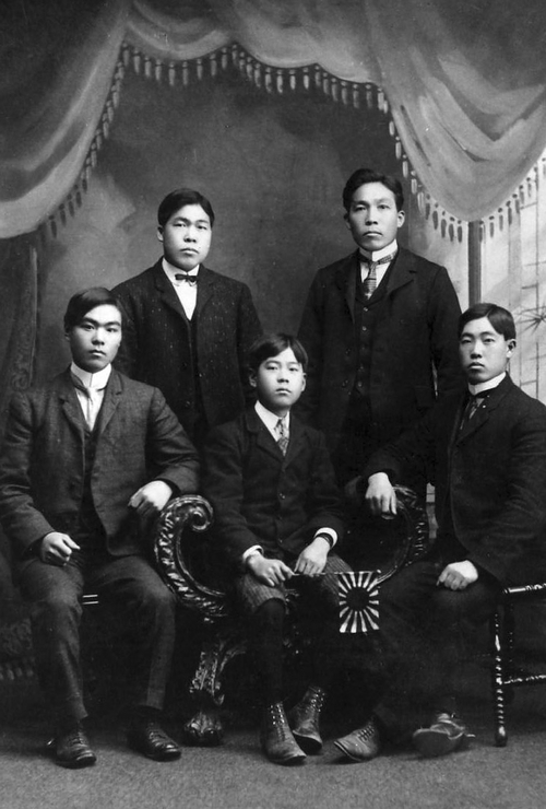 A leading Issei of Utah, Henry Y. Kasai, seated center, surrounded by his cousin, uncle, father, and uncle, circa 1900. Photo Courtesy Utah State Historical Society